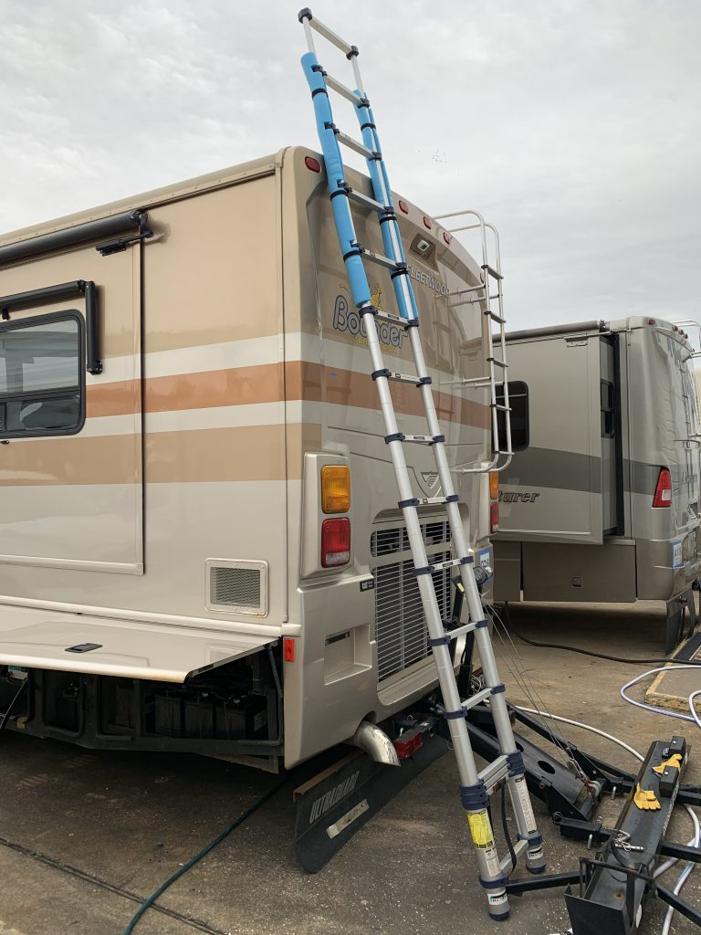 Ladder against back of motorhome